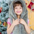 Cute little happy girl posing in a fur hat. — Stock Photo #59281217