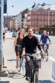 People biking in Copenhagen — Stock Photo