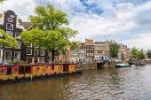 Amsterdam canal and  boats — Stock Photo