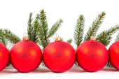 Red Christmas balls and fir branch — Stock Photo