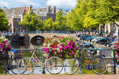 Bicycles on a bridge over canals — Stock Photo