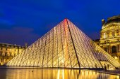 The Louvre at night in Paris — Stock Photo