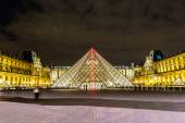 The Louvre at night in Paris — Photo