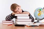Cute schoolboy with books — Stock Photo