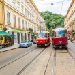 Trams at old street in Prague — Stock Photo #74576195