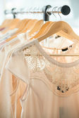 Dresses on a wooden hangers — Stock Photo