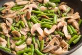 Beans with wushrooms in a pan — Stock Photo