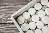 Goat cheese heads in a box  — Stock Photo