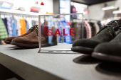 Sale in a shoes store — Stock Photo