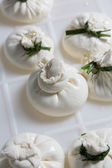 Burrata cheese on a production — Stock Photo