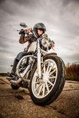 Biker girl on a motorcycle — Stock Photo