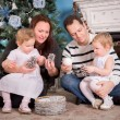 Happy Family and Christmas Tree — Stock Photo #54750547