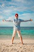Man in santa hat on the tropical beach — Stock Photo