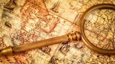 Magnifying glass on ancient map — Stock Video