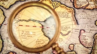 Magnifying glass on the ancient map — Stock Video