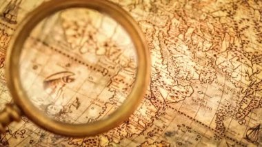 Magnifying glass on ancient map — Vídeo de stock