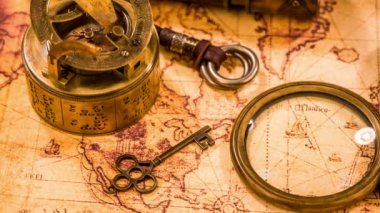 Vintage travel objects on ancient map — Vídeo de Stock