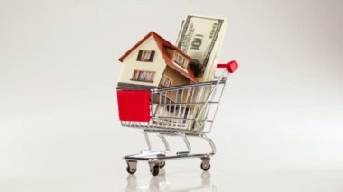 Shopping cart and house — Stockvideo