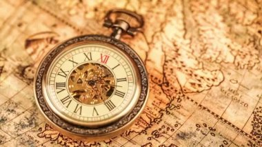 Pocket watch on ancient map — Stockvideo
