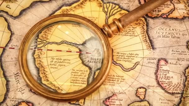 Magnifying glass on the ancient map — Vídeo de stock