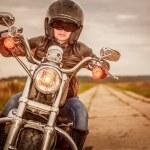 Biker girl on a motorcycle — Stock Photo #61546055