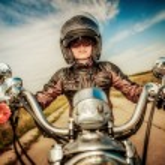 Biker girl on a motorcycle — Stock Photo #61546071