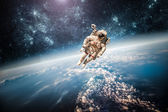Astronaut in outer space — Stock Photo