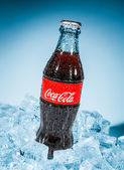 Bottle of Coca-Cola on ice. — Stock Photo