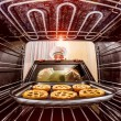 Chef cooking in the oven. — Stock Photo #65048773