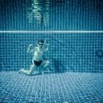 Underwater pool portraying Superman — Stock Photo #65049017
