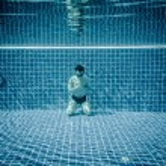 Man praying under water pool — Stock Photo #65049023