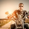 Biker on a motorcycle — Stock Photo #66873921