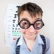 Person wearing spectacles in an office at the doctor — Stock Photo #69526733