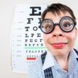 Person wearing spectacles in an office at the doctor — Stock Photo #69526753