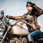 Biker girl on a motorcycle — Stock Photo #70112809