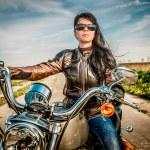 Biker girl on a motorcycle — Stock Photo #70116533
