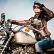 Biker girl on a motorcycle — Stock Photo #70112809