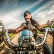 Biker girl on a motorcycle — Stock Photo #70116529