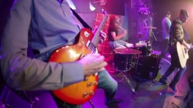 Band performs on stage, rock music concert — Stock Video