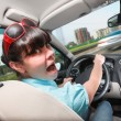 Driving lessons. The woman behind the wheel. — Stock Photo #71311123