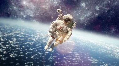 Astronaut in outer space against the backdrop of the planet earth. Elements of this image furnished by NASA. — Video Stock