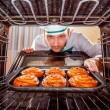 Chef cooking in the oven. — ストック写真 #72876037