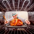 Cooking chicken in the oven. — Foto de Stock   #72876181
