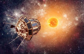 Space satellite on a background star sun — Stock Photo