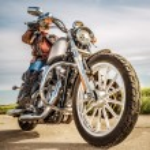 Biker girl on a motorcycle — Stock Photo #81872046