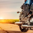 Biker girl riding on a motorcycle — Stock Photo #81872074