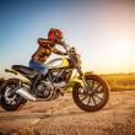 Biker girl on a motorcycle — Stock Photo #81872086