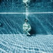 Persons lies under water in a swimming pool — Stock Photo #84811496