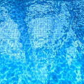 Swimming pool with sun glare on the water — Stock Photo