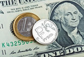 Rubles coin over euro and dollar — Stock Photo